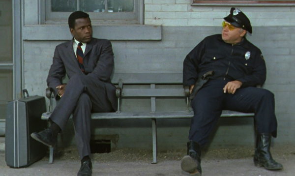 in-the-heat-of-the-night-1967-best-picture-sidney-poitier-rod-steiger-virgil-tibbs-chief-gillespie-train-station-bench-review
