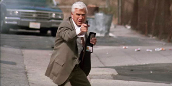 naked-gun-from-the-files-of-police-squad-frank-drebin-shooting-leslie-nielsen-600x300